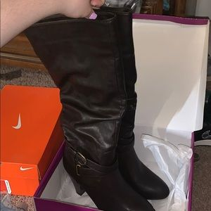 Brown knee high heel boots**PRICE IS NEGOTIABLE